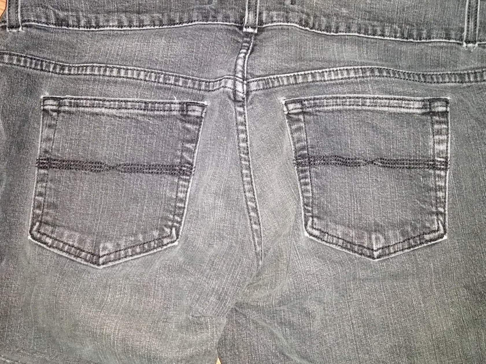 Faded black distressed boot cut jeans size 12R