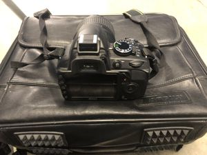 Nikon D3100 w/Zoom lense, battery charger, 2 batteries, bag, and Bower tripod for Sale in Manassas, VA