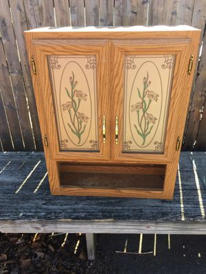 Photo Fancy two door medicine cabinet with glass inserts and shelf