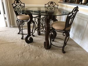 Indoor or Outdoor Dining table with glass top and four chairs for Sale in Rockville, MD