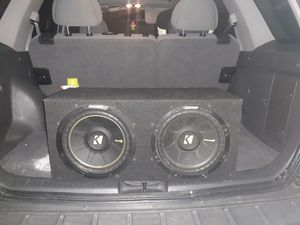 Photo These are two 10 kicker subs in a perfect condition box and amp