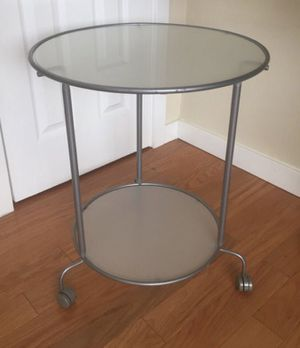 IKEA Heimdal Silver and Glass with wheels Side coffee Table / nightstand for Sale in Alexandria, VA