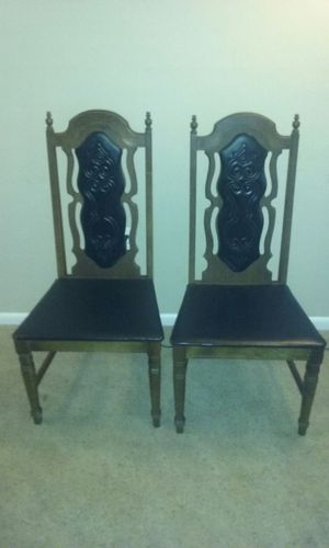 Two antique wood and black leather chairs for Sale in Gaithersburg, MD