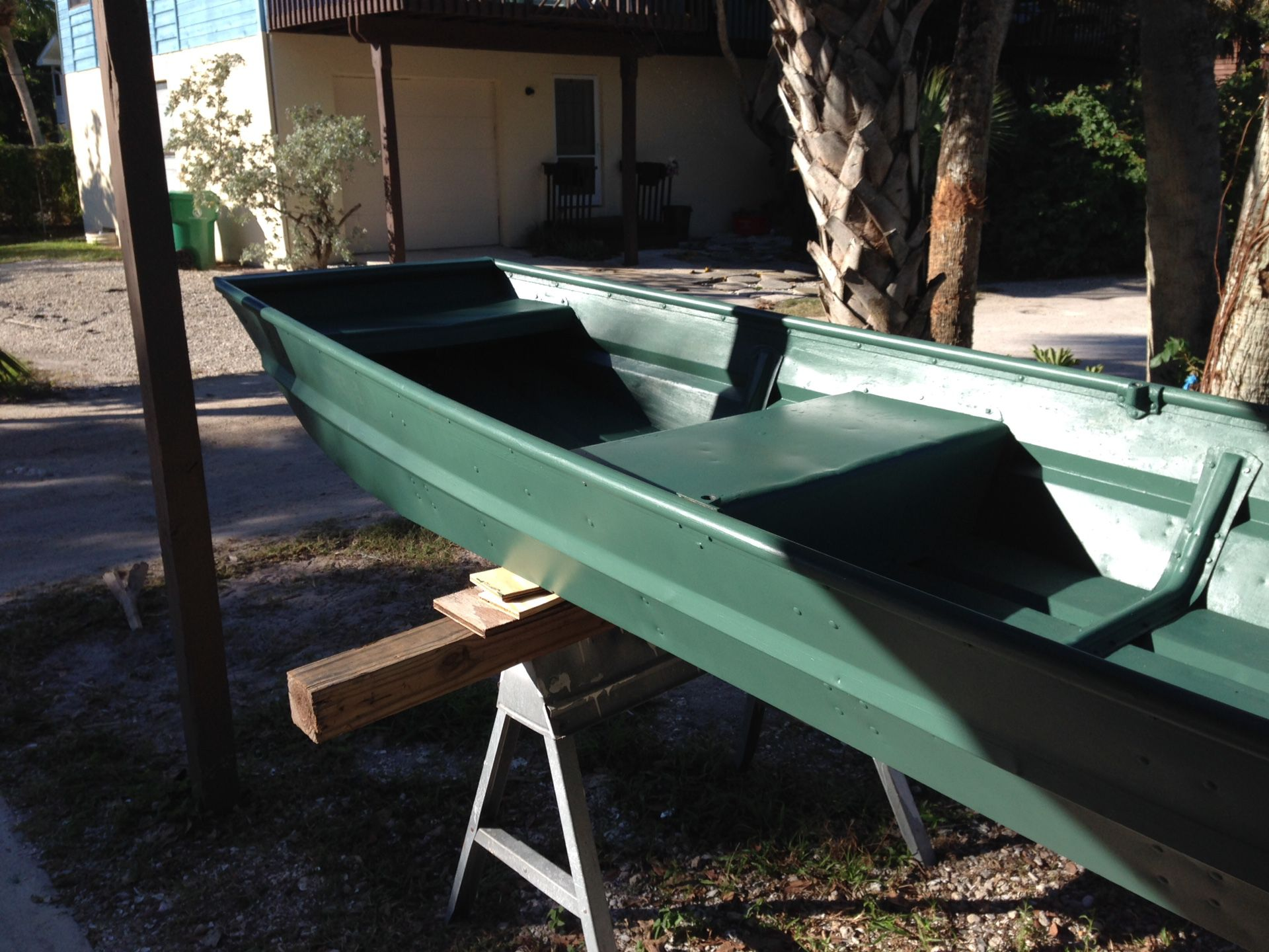 12 ft john boat with 4-1/2 hp mercury and trolling motor and accessories 650.00