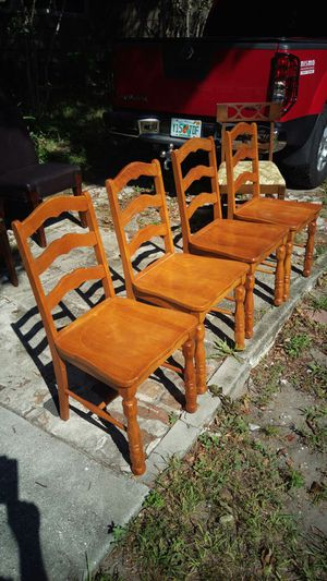 Four nights solid wood chairs $60 a set for Sale in Orlando, FL