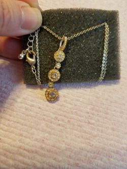 From Avon CZ diamond(April birthstone) gold plated Necklace Please go to my page and see other items that I have listed thank you for your interest Thumbnail