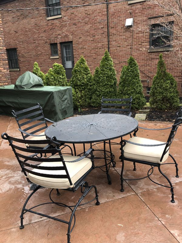 Arhaus Black Wrought Iron Patio Table With Four Chairs And Cushions