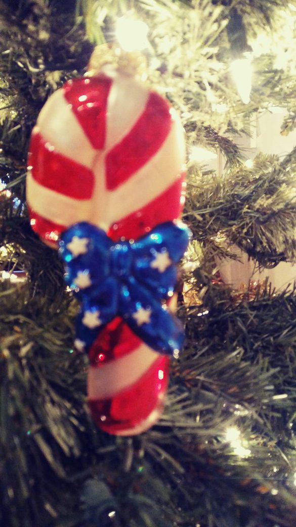 Red white and blue candy cane christmas ornament