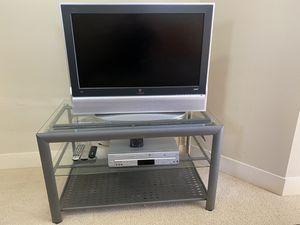 Photo 32 inch Vizio TV, Roku2, Panasonic DVD/VCR, Glass and Metal Stand