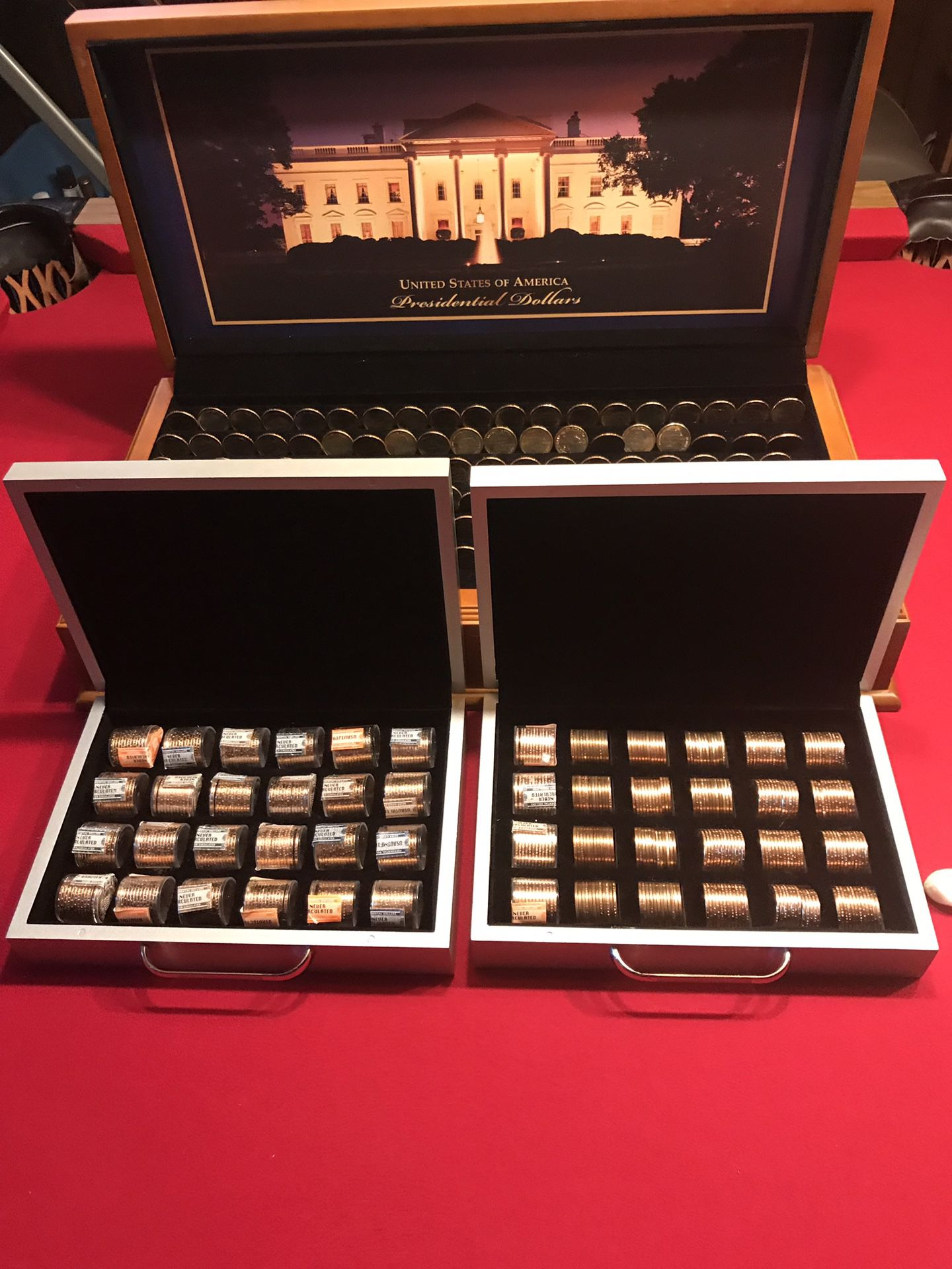 Presidential dollars valued at $2.95 each in today's market. All in a professional case and in touches by human hands. Shipped from the mint to me.
