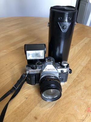 Canon AE-1 Program 35mm SLR Film camera With 100-200 Millimeter lens And Flash. for Sale in Arlington, VA