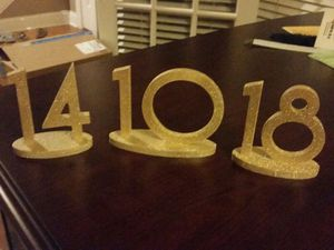 Gold Table numbers- wood & glitter for Sale in Tampa, FL