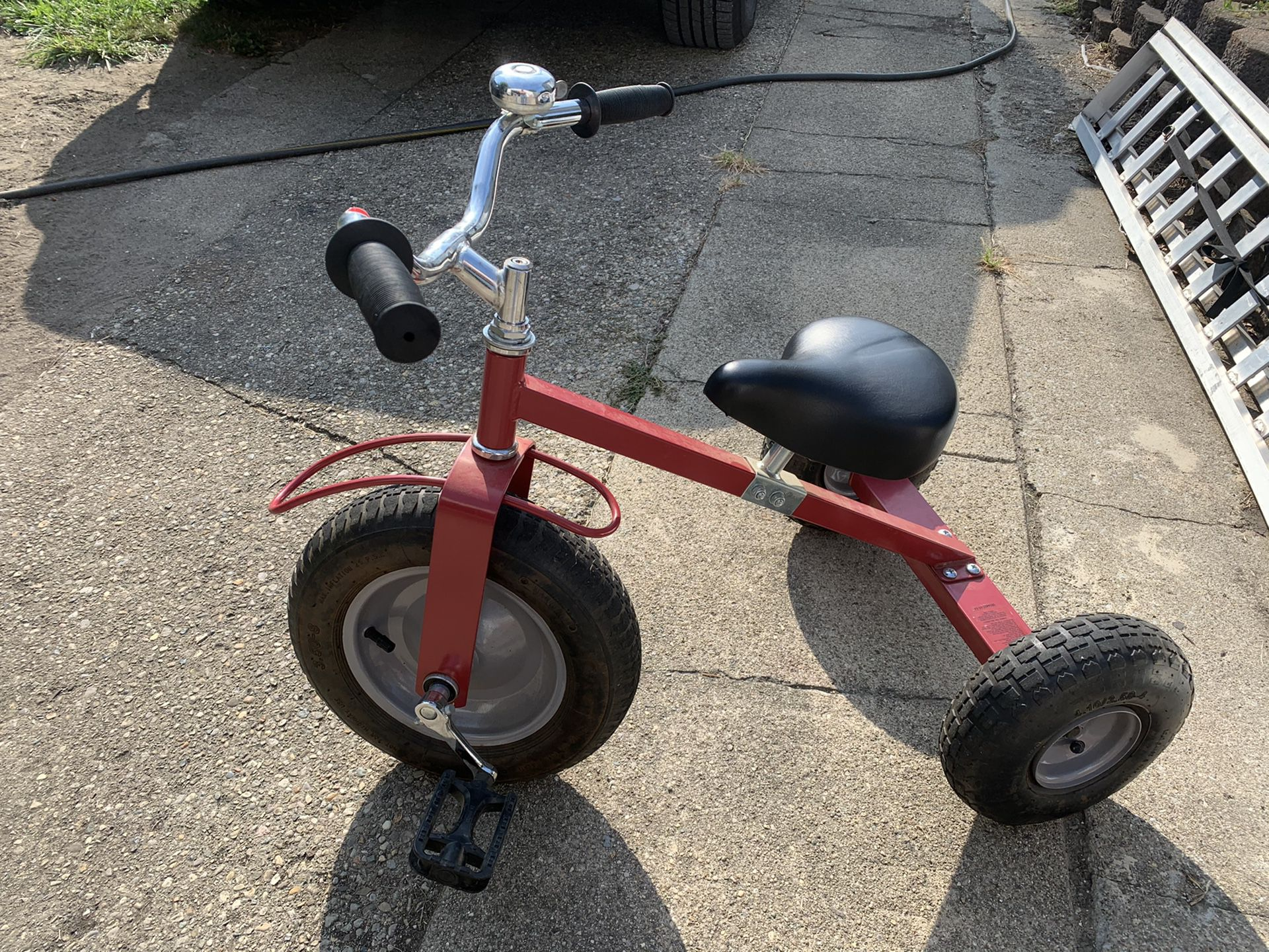 Really nice solid trike has the big tires hold air, adjustable seat as the. child grows