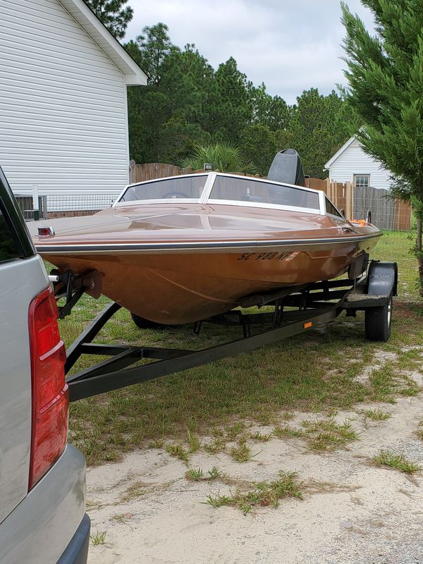 1980 checkmate with trailer and 1983 115 mariner high performance motor. clear titles.