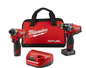 Milwaukee Hammer drill and impact gun kit with batteries and charger for Sale in Orlando, FL
