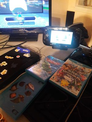Nintendo Wii U.. 4 games an extra controller for Sale in Blytheville, AR