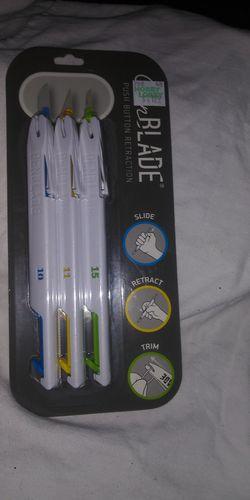 Pens and cutting blades. 5.00 ea. Thumbnail