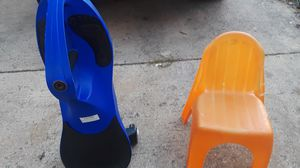 Blue wheeled toy, Orange kids chair for Sale in Falls Church, VA