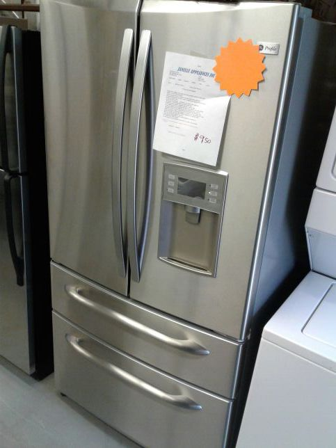 GE profile four doors French doors refrigerator excellent condition working perfectly