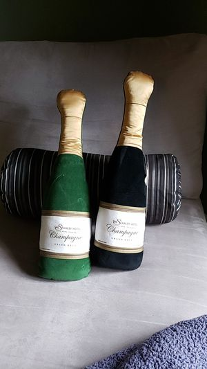 Sofa pillows, champagne bottle.shaped for Sale in Lutherville-Timonium, MD