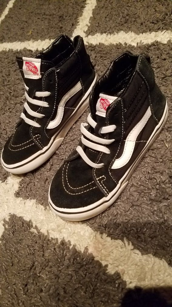 Black and white high top Vans