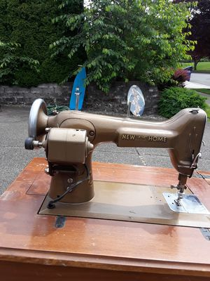 Photo New home antique sewing machine