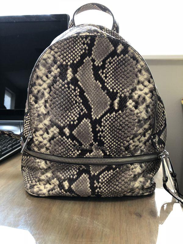 5d1fd8b77f14 Michael Kors Snakeskin Backpack for Sale in Harrison, AR - OfferUp