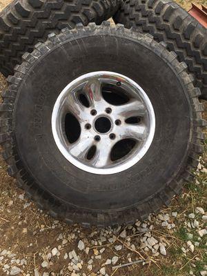 Photo 37 inch buck shot mud tires on six bolt aluminum wheels