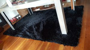 Black area rug, with silver strand highlights. for Sale in Tacoma, WA