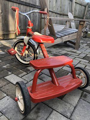 Photo Retro style Red Schwinn Tricycle