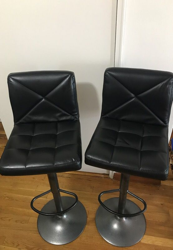 Adjustable height barstools - less than a year old