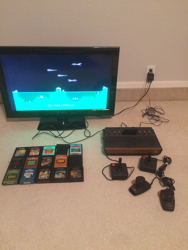 Atari 2600 wood grain 6 switch, 2 joystick controllers, paddle controller,  and 16 games for Sale in Broken Arrow, OK - OfferUp