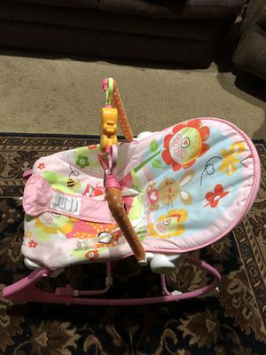Baby swing, Bassinet with three bows pink (shown) green, blue, Two piece Musical Bouncer for Sale in Gaithersburg, MD