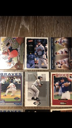 I have basically the whole late 90s to early 2000 ATLANTA BRAVES baseball cards it wouldnt let me post all of them Thumbnail