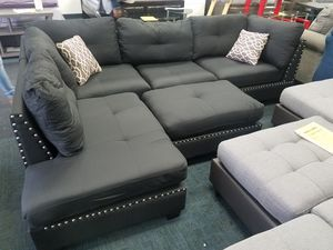 Brand new nailhead trim black linen material sectional free Ottoman and accent pillows for Sale in College Park, MD