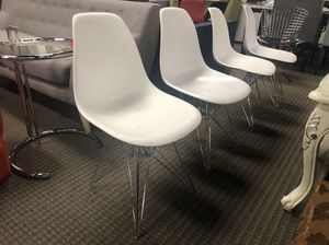 Set of 4 white eames style dining chairs with scratches for Sale in Lincolnia, VA