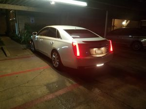 Photo Cadillac xts 2014 superlow milage 49000 only!! rebuilt salvage title in hand due to side hit(have accident pics) drives like new CHEAP DEAL
