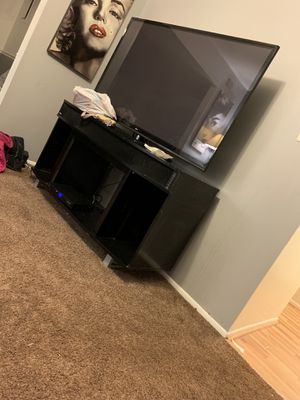 60incH LG TV WHIT STAND for Sale in Springfield, VA