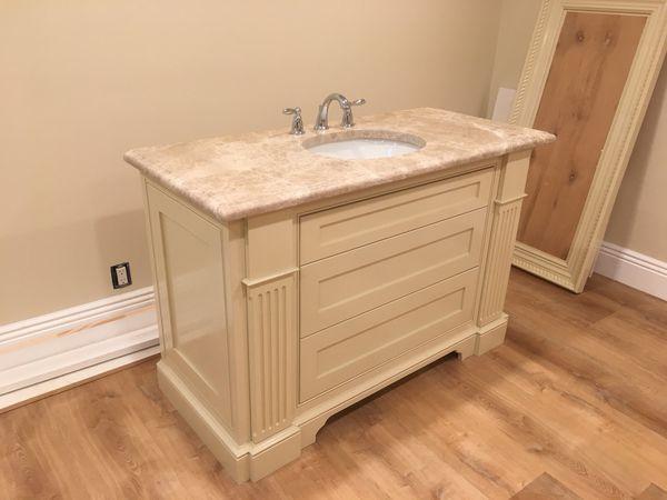 Custom Bathroom Vanity With Marble Counter Top Sink And Backsplash