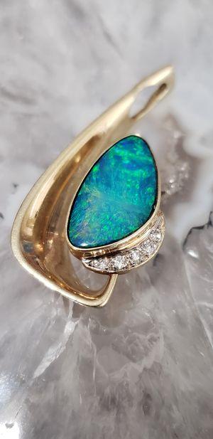Photo 14 k opal and diamond pendant