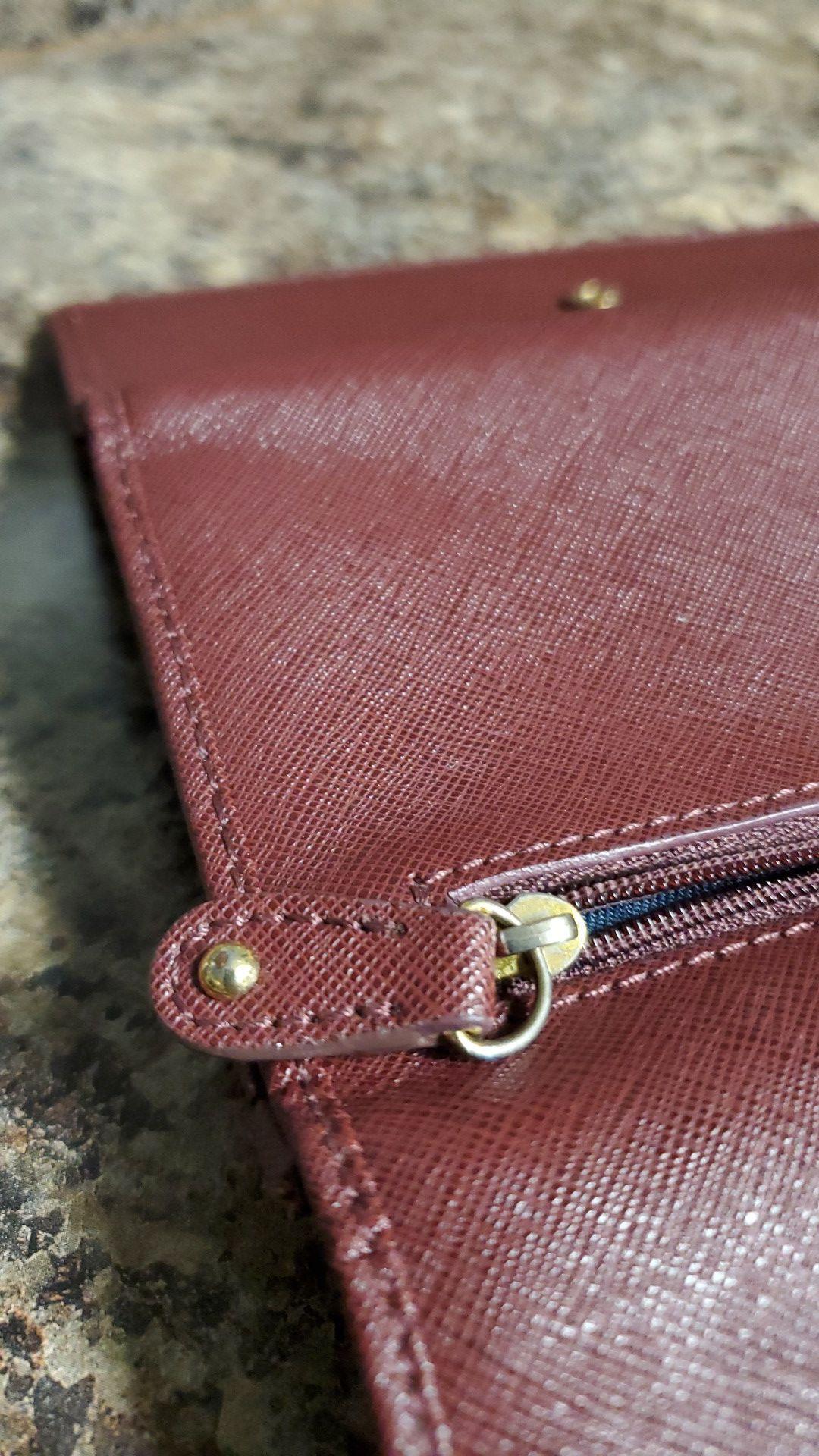 Maroon Tommy Hilfiger wallet.