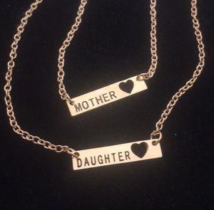 Gold colored mother daughter set. for Sale in Denver, CO