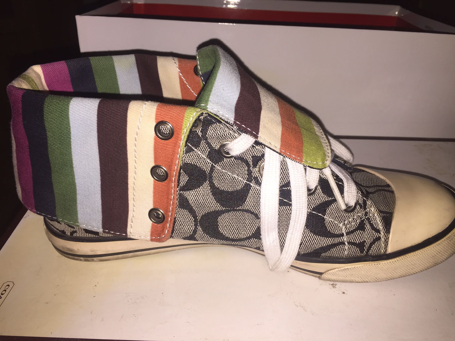 Coach Tennis shoes high tops. Size 8.5 in very good condition. $60.00.