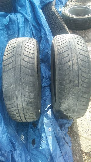 Photo Pair of 225-65-17 inch tires