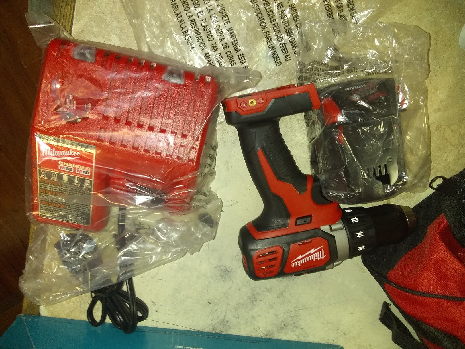 Milwaukee drill with charger and battery brand new