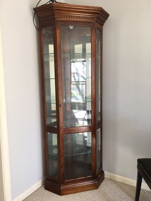Wood corner cabinet with glass and wired lighting for Sale in North Potomac, MD