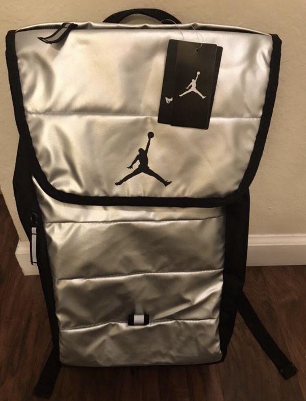 9b06f86f9322a2 Brand new with tags Silver and black Jordan backpack with laptop storage  inside for Sale in Concord