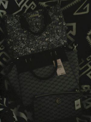 f34b805cfbdc Michael Kors purses and wallet. for Sale in Wichita
