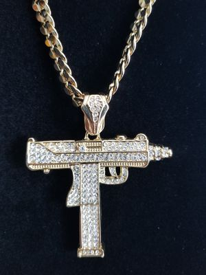 Photo 14k gold filled iced out uzi gun pendants, on thick cuban chain.