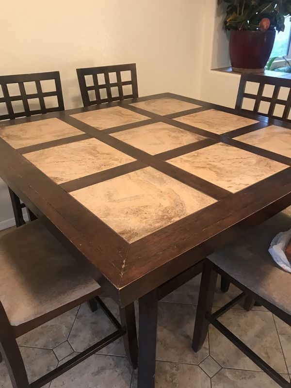 large tiletopped kitchen table with six matching chairs
